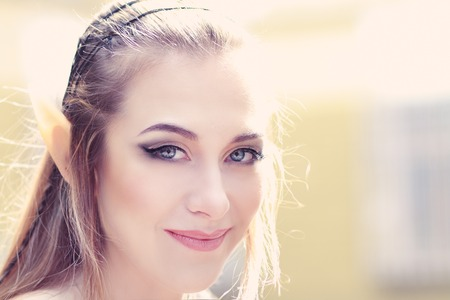 sexy xmas elf: Stylish portrait of a beautiful young girl elf princess magical fashion toning Stock Photo