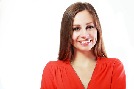 one female: Headshot portrait of smiling happy latin woman looking at camera on isolated studio - copyspace Stock Photo