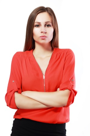 snoot: woman standing with folded arms and pursing lips