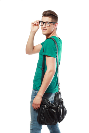 back pack: young man college student with back pack and glasses leaving