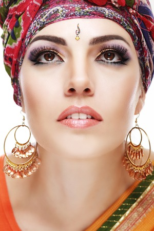 Portrait of beautiful woman wrapped in scarf with Indian tikka close up