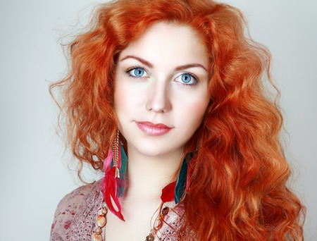 long red hair woman: Portrait of a young woman with red hair and blue eyes