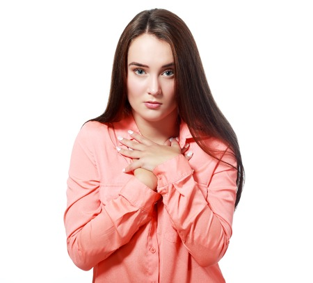 facial gestures: Closeup portrait of young woman looking away saying sorry I made a mistake through body language and hand gestures. Isolated on white background. Negative human emotions facial expressions feelings Stock Photo