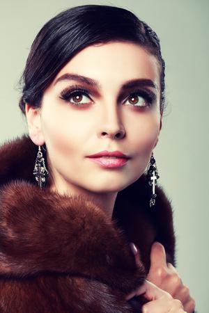 hair colour: beautiful woman wearing earrings beauty shot close up Fashion retro toning.