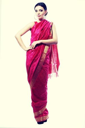 body toning: Full body traditional Indian beautiful fashion model girl in sari costume Fashion retro toning.