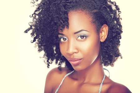 Beautiful black woman face with perfect make up over white Fashion retro toning.