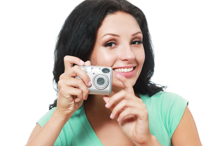 compact camera: Full isolated studio picture from a young and beautiful woman with compact camera