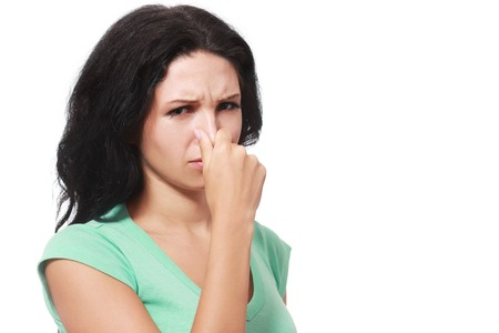 twentysomething: Covering her nose after a bad smell Stock Photo