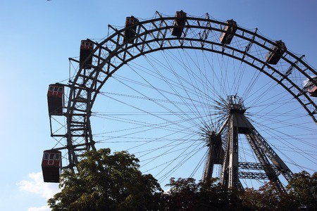 hype: VIENNA, AUSTRIA - AUGUST 22 Famous and historic Ferris Wheel of vienna prater park called Wurstelprater ; Prater Amusement Park Large public park; August 22, 2015 in Vienna, Austria.