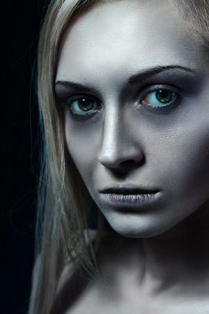looked: Portrait of beautiful zombie corpse bride looked scary and standing at dark background. Halloween concept Stock Photo