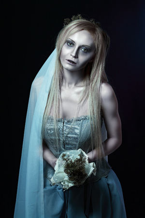 corpse: Portrait of beautiful zombie corpse bride looked scary and standing at dark background. Halloween concept Stock Photo