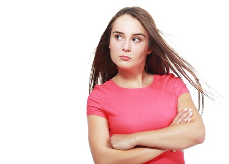 confuse: confused and angry or mad teen girl funny face Stock Photo