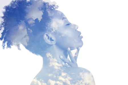 Double exposure portrait of attractive african american woman combined with photograph of cloudy sky