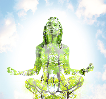 sport, fitness, yoga, double exposure and people concept - happy young woman meditating in lotus pose over blue sky and green tree background Stockfoto