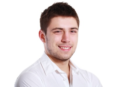 headshot: Cheerful young man, isolated over white background Stock Photo