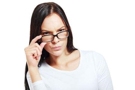 bitchy: pretty suspicious woman posing with glasses