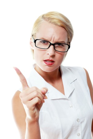 strict: Strict teacher woman threatens by finger isolated over white Stock Photo