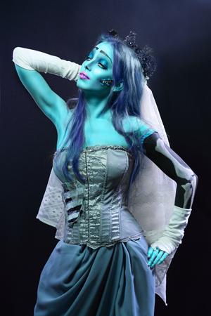 daunting: Halloween: Sorrow scene of a corpse bride under blue moon light. Beautiful ghost zombie