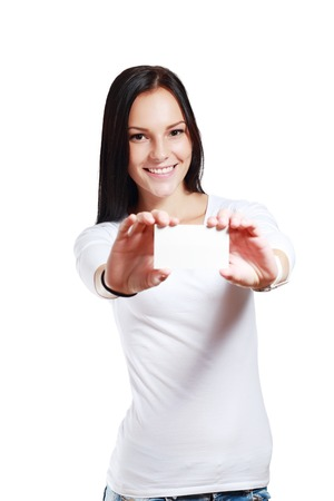 Teenager girl hold white blank paper. Young smiling woman show blank card. Girl portrait isolated on white background.