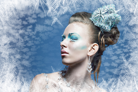 blue metal: ice-queen. Young winter woman in creative image with silver blue artistic make-up and perfect hairstyle.