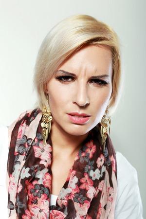 suspiciously: woman looking at camera suspiciously screw up eyes
