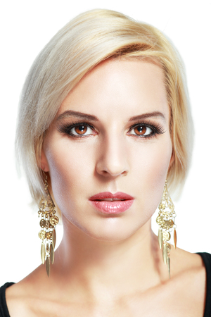chic woman: Glamour woman model with perfect evening make-up & chic shiny jewellery.  Fashionable close-up portrait.
