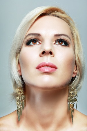 fake eyelashes: beautiful young blond woman face closeup wearing vogue long lashes and bright pink lipstick - naturally beautiful skin texture
