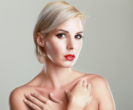 shiny hair: beautiful blond woman with short haircut with pefect skin fashion toned image
