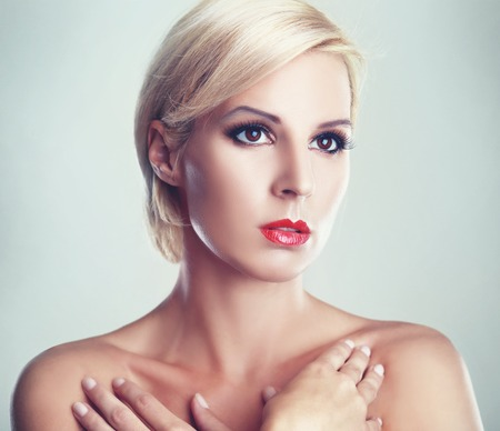 short haircut: beautiful blond woman with short haircut with pefect skin fashion toned image