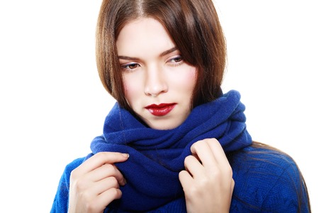 elegance fashion girls look sensuality young: Close up portrait of smiling beautiful brunette female in blue sweater fashion shot Stock Photo
