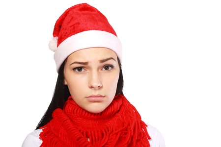 scruple: The girl in Santas hat with a dissatisfied look.