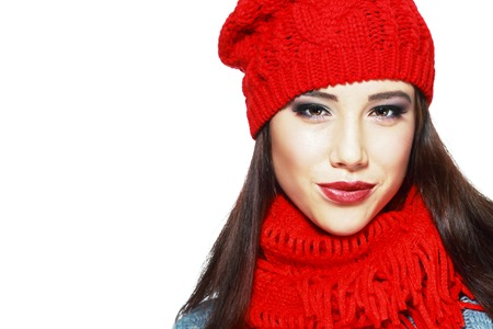 cute christmas: happiness concept - trendy woman in red hat and muffle Stock Photo