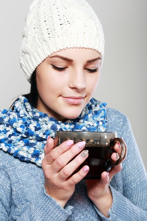 bound woman: Young woman in warm sweater hold hot cup of tea Stock Photo