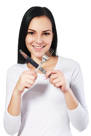 young knife: beautiful young woman isolated woman with fork and knife Stock Photo