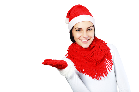 red evening: Woman in Christmas cap gestures palm up