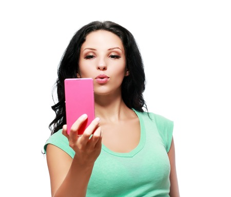 self   portrait: pretty girl make a duck face, and take a self portrait with her smart phone
