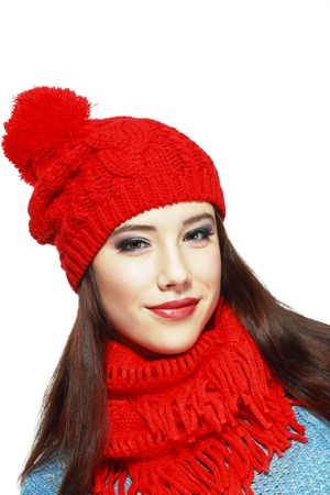 to muffle: happiness concept - trendy woman in red hat and muffle Stock Photo