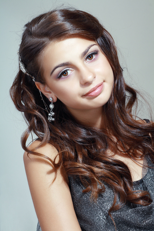 Fashion Beauty Portrait of teen model girl. Healthy Hair. Hairstyle. Holiday Makeup