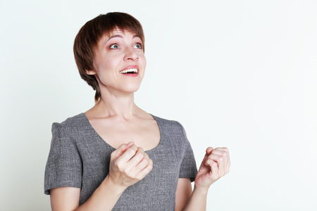 25 29: Cheerful middle age woman is excited because of something.Excited woman Stock Photo