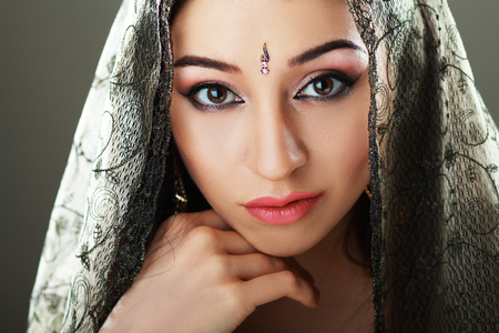 indian culture tradition: Indian beauty face close up perfect make up. Series. young beautiful brunette in traditional national dress Stock Photo