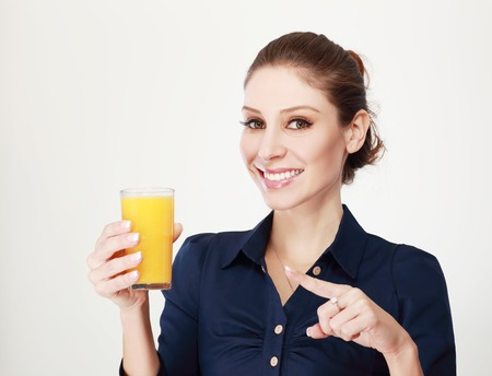 smile close up: Young woman close up portrait drink juice. Female model happy smile.