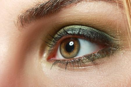 eye hole: extreme closeup of beautiful womanish eye with glamorous khaki smoky makeup macro