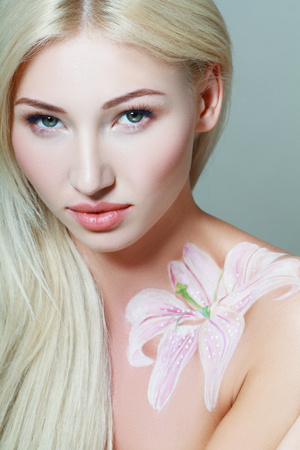 bodyart: portrait of beautiful girl with floral theme bodyart