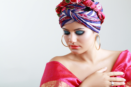 turban: Young woman in turban and with artistic visage and false eyelashes Stock Photo