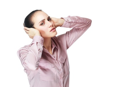 hands over ears: Portrait of young business woman covering with hands her ears, isolated over white background Stock Photo
