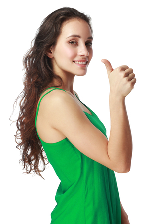 handsign: Happy smiling beautiful young brunette woman showing thumbs up gesture