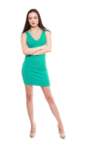 teethy: Fashion model wearing green dress with emotions Stock Photo