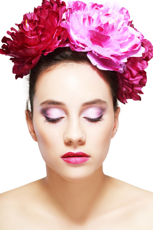 anti ageing: Young beautiful healthy brunette girl with pink flowers in her hair