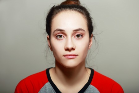makeup eyes: Close-up face portrait of young woman without make-up. Natural image without retouching . Shallow depth of field. Stock Photo