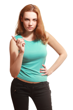 threatens: Beautiful Frowning and Angry Woman Scolding and pointing a finger, Threatens. Emotional Portrait, white background
